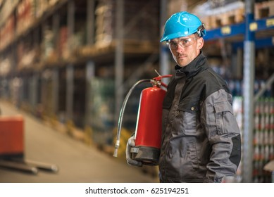 Caucasian warehouse worker with fire extinguisher