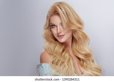 caucasian white woman with curly and shiny hair looking into camera