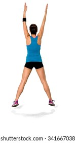 Caucasian woman black in athletic costume doing jumping jacks - Isolated