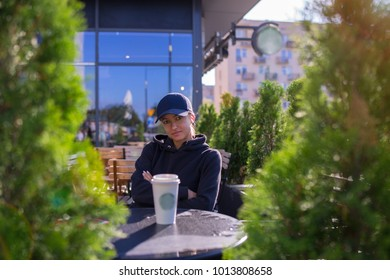 caucasian woman drinking hot beverage coffee outside