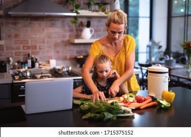 Caucasian woman enjoying her time at home with her daughter. Social distancing and self isolation in quarantine lockdown for Coronavirus Covid19