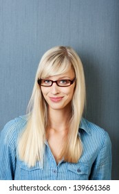 Caucasian woman with glasses over the blue background