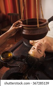 Caucasian woman having Ayurveda shirodhara treatment in India