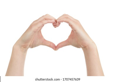 caucasian woman holding her hands in the shape of a heart as a sign of love on white isolated studio background