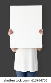 Caucasian Woman is Holding Placard