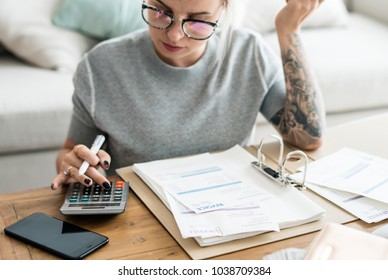 Caucasian woman with invoice bills