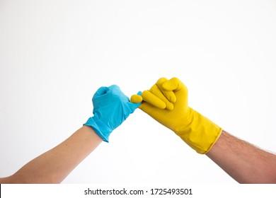 Caucasian woman and man hands and arms in blue and yellow latex gloves doing the pinky swear sign isolate on white 2020