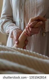 Caucasian woman massaging caucasian womans hand