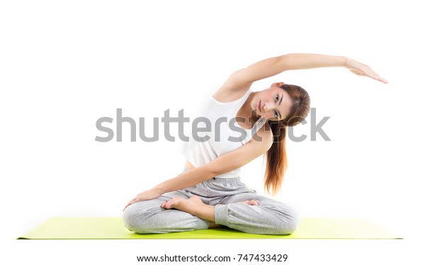 Caucasian woman practicing yoga concept of healthy life and natural balance between body and mental development on white background
