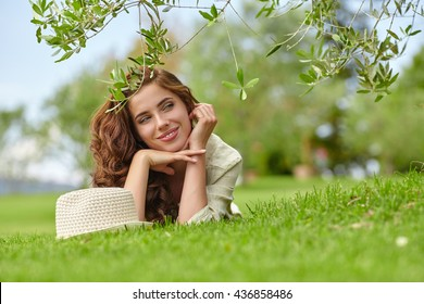 Caucasian woman smiling happy on sunny summer or spring day outside in garden.