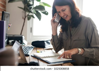 Caucasian woman talking business on the phone