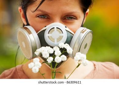 caucasian woman is wearing a gas mask