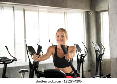 Caucasian women are smile happy while exercise at bike in the gym. fitness and healthy lifestyle concept.