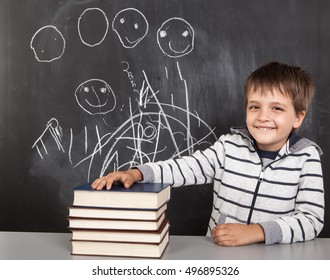 Caucasian young boy sitting with books