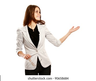 Caucasian young female mode in suit pointing at something. isolated on white background