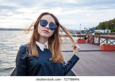 Caucasian young girl with eyeglasses by the sea