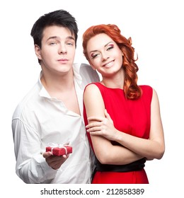 caucasian young happy couple holding red gift isolated in white