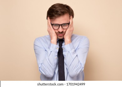 Caucasian young man with vertigo. Young male coworker suffering from dizziness.