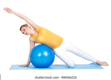 Caucasian young woman exercising yoga for pregnant with blue fitball in studio isolated on white background. Happy blonde pregnant woman exercising on exercise ball. pregnant woman practicing yoga