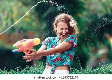 Caucasian young woman  fight with water gun in the Songkran festival. Holiday concept. Thai new year
