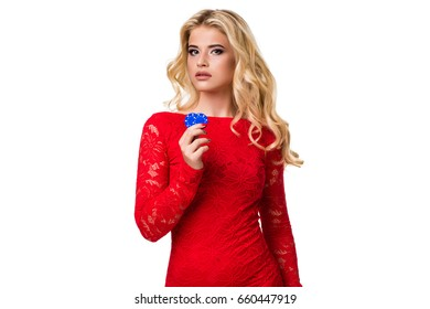 Caucasian young woman with long light blonde hair in evening outfit holding playing chips. Isolated. Poker
