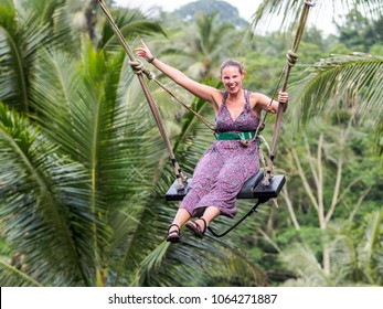 caucasion woman having fun at Bali swing
