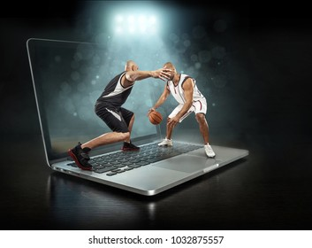 Caucassian Basketball Players in dynamic action with ball in a professional sport game play on the laptop.