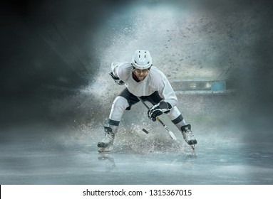 Caucassian ice hockey Player in dynamic action in a professional sport game play in hockey under stadium lights.