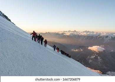 Caucasus / Russia - 06/08/2018 Group of climbers climbing mountain peak Elbrus