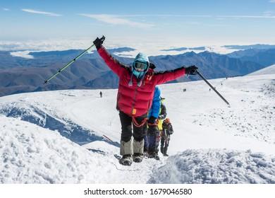 Caucasus / Russia - 18/09/2018 Group of climbers climbing mountain peak Elbrus