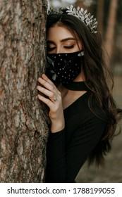 Caucazian girl wears respirator mask to protect herself from coronavirus, respiratory disease, realises epidemic outbreak.