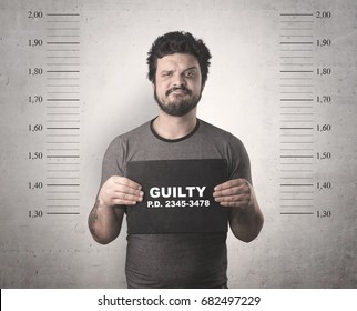 Caught guilty man with ID signs on his hand.