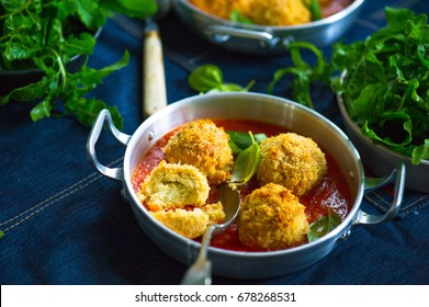cauliflower arancini stuffed with mozzarella cheese