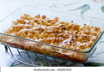 cauliflower baked with cheese in a glass container on a metal lattice