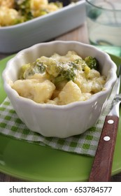 Cauliflower and broccoli cheese in a baking dish on a rustic table