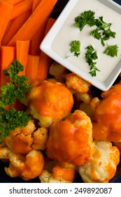 Cauliflower Buffalo BItes with Carrots and Dip