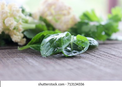 cauliflower, cabbage, broccoli on the table with parsley