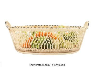 cauliflower. carrot. broccoli. slice. in basket wooden. isolated on white background.