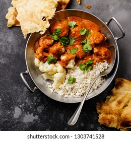 Cauliflower Curry and rice on gray background