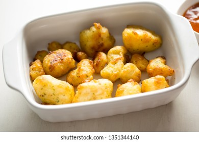 Cauliflower popcorn, coated mini cauliflower florets in a light batter with a spicy Buffalo dip