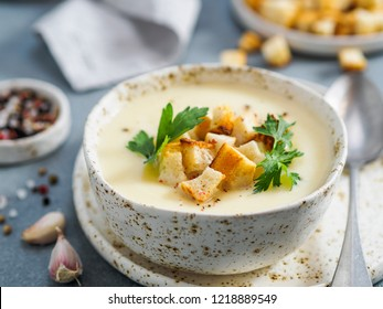 cauliflower potato soup puree on stone background,Creamy cauliflower soup with toasted bread croutons.Vegetarian healthy food concept. Ideas and recipes for winter meal.Shallow DOF.Copy space for text