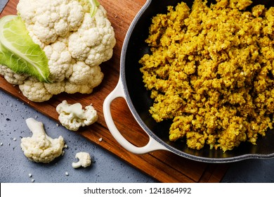 Cauliflower Rice with spices in cooking pan and Raw Cauliflower close-up