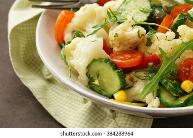 Cauliflower salad with cucumbers and colored pepper