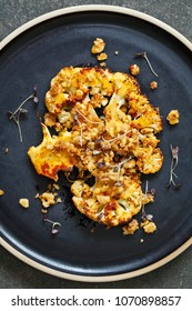 Cauliflower steak with harissa paste and walnuts
