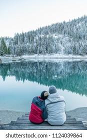 Caumasee, Flims / Switzerland -  November 15, 2017: couple seating admiring the view and enjoying the company