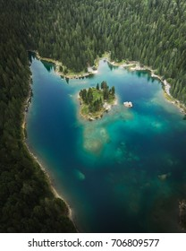Caumasee is a lake near Flims, Switzerland and is surrounded by a huge forest. There is a small island located in the middle of the crystal clear lake.