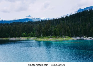 Caumasee lake with a small island located in the middle of the crystal clean lake, near Flims, Switzerland.