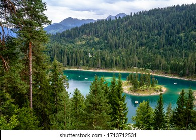 Caumasee lake with a small island located in the middle of the crystal clean lake, Caumasee Flims, Switzerland. 22 June 2016