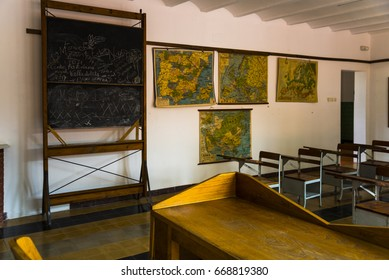Caunedo - Asturias - Spain. June 23th, 2017: Old school classroom with antique maps in the walls