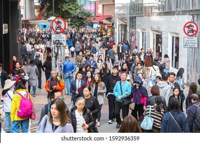 Causeway Bay, Hong Kong - 10 December, 2019 : People walk in Causeway Bay district. Causeway Bay is one of the major shopping areas in Hong Kong.